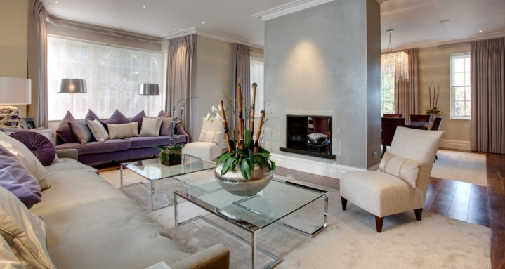 Formal living room with in-ceiling Bowers & Wilkins loudspeakers