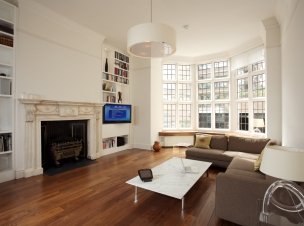 Living Room with Plasma on Pull & Rotate wall bracket